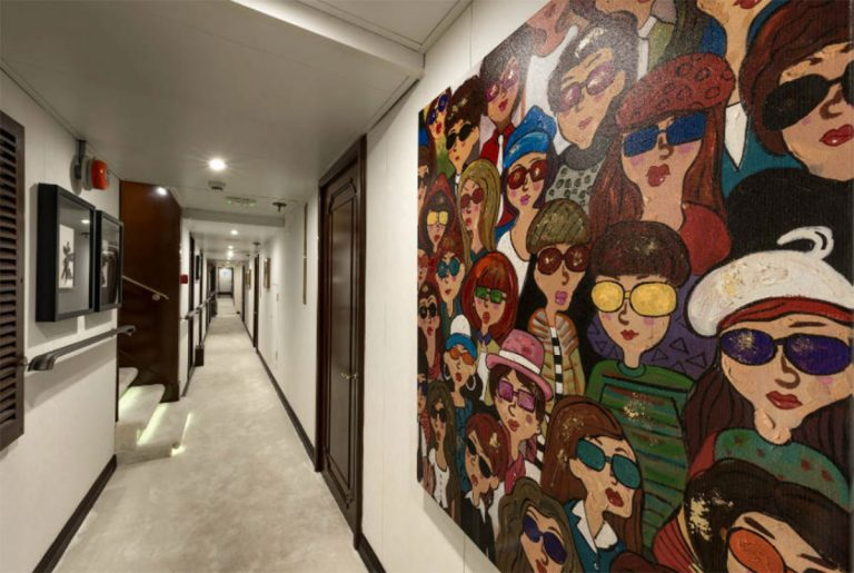 Art on board Chakra featuring modern paintings and sculptures adds the perfect details to an already cheerful with positive aura environment.