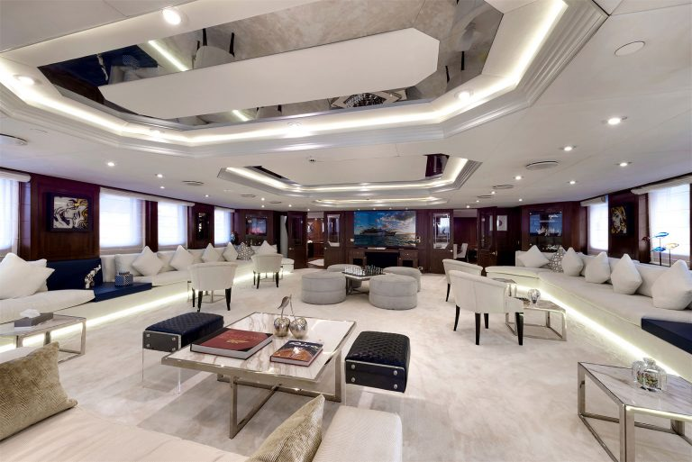 Contemporary interior in a perfect blend of materials , SOLAS bright textiles, ors, thick carpets, art on board and the aura of a classy simplicity.