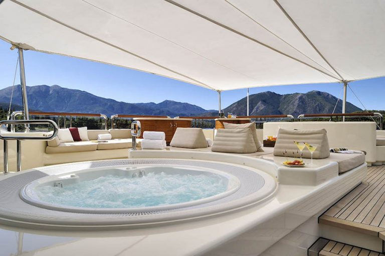 Fabulous decks with convertible area to lounger or sofa with tables and a warm water jacuzzi for all hours on board.